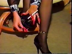 Hot Cougar With Sexy Nails and Heels Smoking Solo