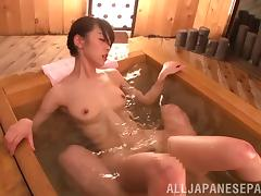 Her hairy Asian pussy is hammered in a hot tub by an older guy
