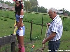 Slutty farm girl in rubber gloves and grandpa fuck outdoors