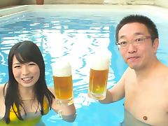 Vacationing Japanese couple fuck in the pool at the hotel