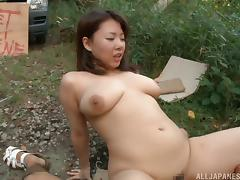 Big boobed Asian girl with a trimmed pussy fucking outdoors