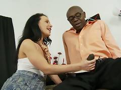 Tattooed cougar with long dark hair sucking a massive black cock