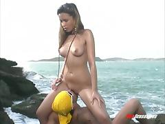 Brazilian hottie sucks a man's thick cock by the ocean