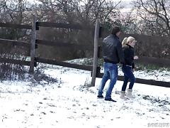 Couple kissing in the snow before their erotic afternoon sex