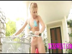 sexy young blonde on a bike