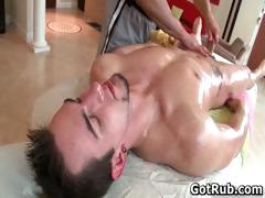 Hunky dude gets his smooth body massaged