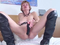 Granny in hot knee high boots fingering her still tight pussy
