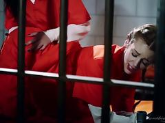 Pair of attractive inmates having a lesbian session in the prison