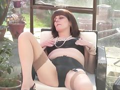 Very horny granny decides to masturbate her pussy on the porch
