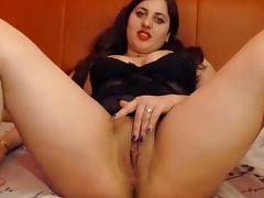 Fancy girl rubs her pussy on cam