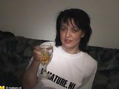 Sexy Dutch cougar decides to masturbate with a bottle of Serbian beer