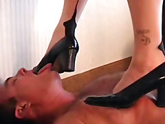 Horny businesswoman tortures her humble sex slave