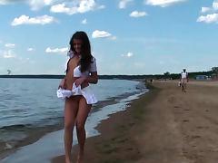 Beautiful flashing girl at the beach