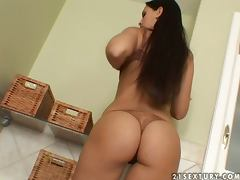Eve Angel fingers and toys her pussy lying in a bathtub