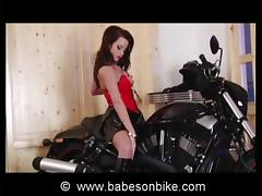 Sexy gal is naughty on bike
