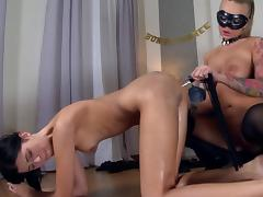 Masked mistress inserts a bottle in her slave's asshole