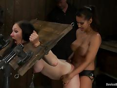 Isis Love fucks two nasty chicks with a strapon in BDSM scene
