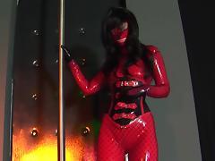 Masked brunette Olga poses on the shaft