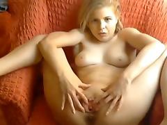 Horny blonde masturbates during sexy chat