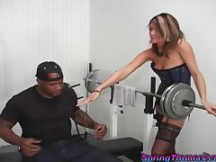 A sexy White babe has an interracial sex in a gym