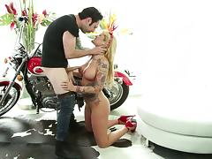 Busty tattooed blondie gets hammered by cocky biker