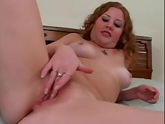 Girl rubs her pink pussy