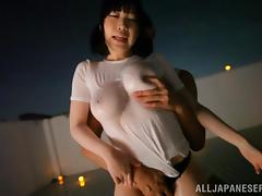 Big-breasted Japanese milf plays with her natural oiled tits